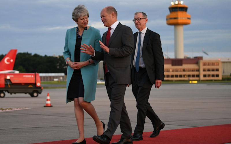Prime Minister Theresa May and husband Philip arrive in Hamburg for the G20 leaders' summit - Credit: PA