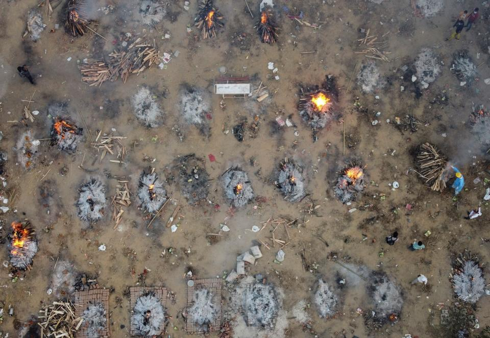 A mass cremation of victims who died due to the coronavirus disease (COVID-19), is seen at a crematorium ground in New Delhi, India, April 22, 2021. Picture taken with a drone. REUTERS/Danish Siddiqui     TPX IMAGES OF THE DAY