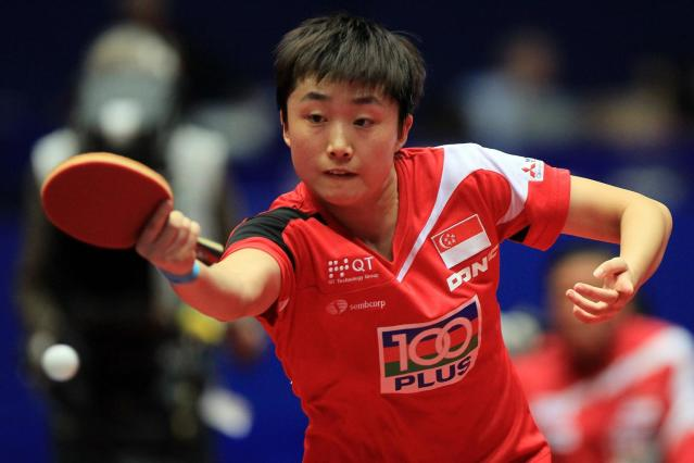 Feng Tianwei of Singapore plays a backhand during her match against Seok Ha Jung of South Korea during the LIEBHERR table tennis team world cup 2012 championship division women's semi final match between South Korea and Singapore at Westfalenhalle Dortmund on March 31, 2012 in Dortmund, Germany.
