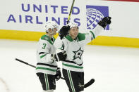 Dallas Stars' Jason Robertson, right, celebrates his game winning goal with John Klingberg during the overtime period of an NHL hockey game against the Chicago Blackhawks Monday, May 10, 2021, in Chicago. (AP Photo/Charles Rex Arbogast)