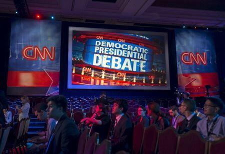 Reporters get a tour of the room where democratic presidential candidates will debate at the Wynn Hotel in Las Vegas, Nevada October 13, 2015. REUTERS/Mike Blake