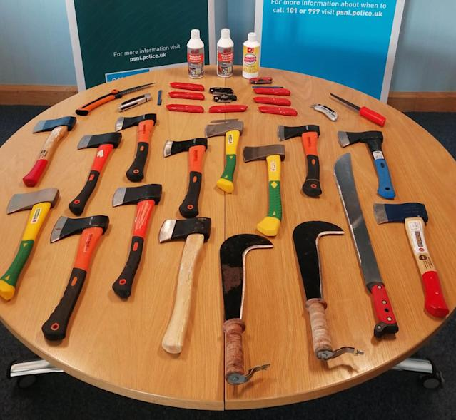 Hatchets and Stanley knives among weapons seized by police as two people were arrested after a disturbance at a funeral (PA)