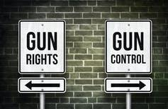 Sign that says 'gun rights' with an arrow pointing one way and sign that says 'gun control' with the arrow pointing in the opposite direction.