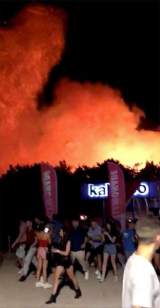 PHOTO: People walk following a fire during the Fresh Island Festival in Novalja, Croatia July 16, 2019, in this still image taken obtained from social media video. (@SHH350 via Reuters)