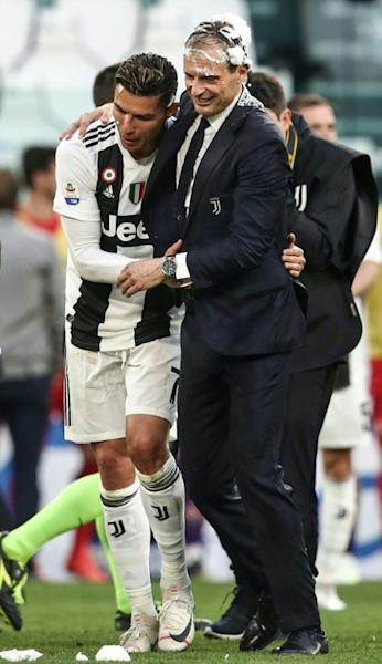 """Next year is a new page:"" Cristiano Ronaldo (L) and coach Massimiliano Allegri (R) confirmed they are staying at Juventus"