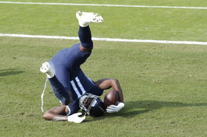 Tennessee Titans wide receiver A.J. Brown (11) catches a touchdown pass against the Baltimore Ravens in the first half of an NFL wild-card playoff football game Sunday, Jan. 10, 2021, in Nashville, Tenn. (AP Photo/Mark Zaleski)