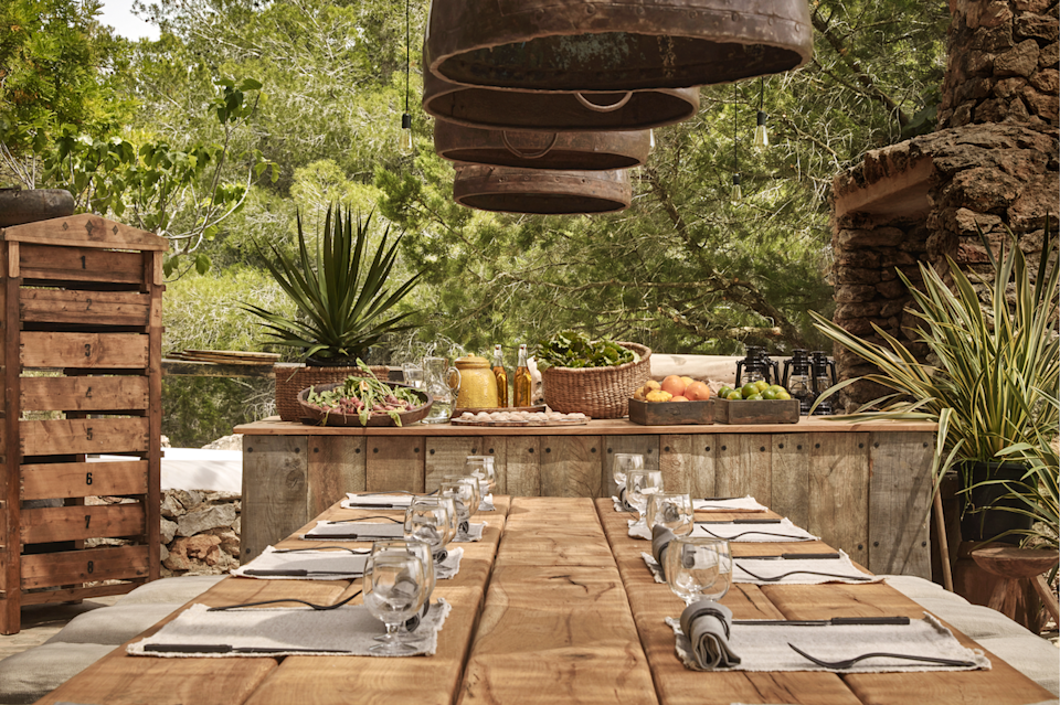 """<p>This earthy outdoor space lies in Ibiza's <a href=""""http://www.lagranjaibiza.com/"""" rel=""""nofollow noopener"""" target=""""_blank"""" data-ylk=""""slk:La Granja"""" class=""""link rapid-noclick-resp"""">La Granja</a>, a biodynamic farm and inn. The farm's design is heavily influenced by <a href=""""https://japanology.org/2016/04/what-does-wabi-sabi-mean/"""" rel=""""nofollow noopener"""" target=""""_blank"""" data-ylk=""""slk:wabi-sabi"""" class=""""link rapid-noclick-resp"""">wabi-sabi</a>, the Japanese art of embracing the natural — flaws and all — which leans towards a more rustic, organically styled home. We love this relaxing outdoor bar, inviting one and all, not only to dine, but to simply be. </p>"""