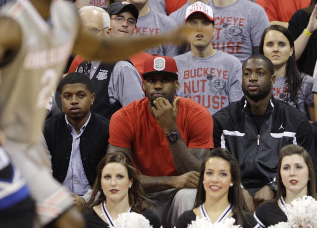 "<a class=""link rapid-noclick-resp"" href=""/nba/players/3704/"" data-ylk=""slk:LeBron James"">LeBron James</a> has made several appearances at Ohio State sporting events over the years. (AP)"
