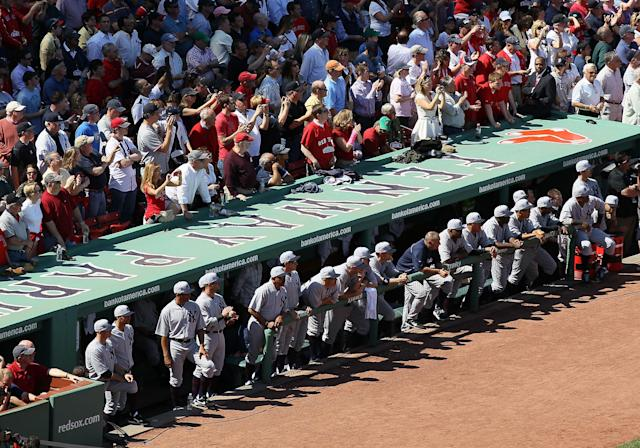 BOSTON, MA - APRIL 20: The New York Yankees watch the 100 Year ceremony from their dugout before the game against the Boston Red Sox on April 20, 2012 at Fenway Park in Boston, Massachusetts. Today marks the 100 year anniversary of the ball park's opening. (Photo by Elsa/Getty Images)