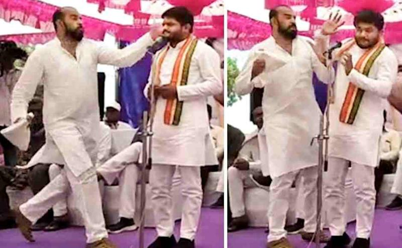 In this combo picture taken from a video footage, Congress leader Hardik Patel is slapped by a man, later identified as Tarun Gajjar, while he was addressing 'Jan Akrosh' (public anger) rally in Surendranagar, Gujarat on Friday. PTI
