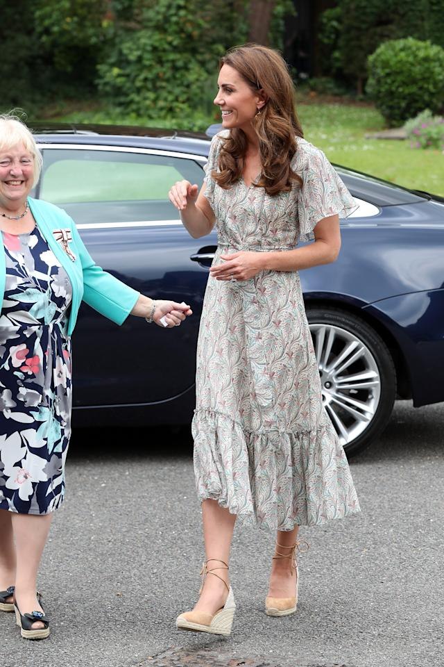 "The Duchess of Cambridge wore a paisley print tea dress by <a href=""https://ridleylondon.com/collections/dresses-1/products/virginia-midi-3"">Ridley London </a>with her Castaner 'Cabrina' espadrille wedges and her <a href=""https://fave.co/2NfCY8B"">Catherine Zoraida earrings</a>. [Photo: Getty]"