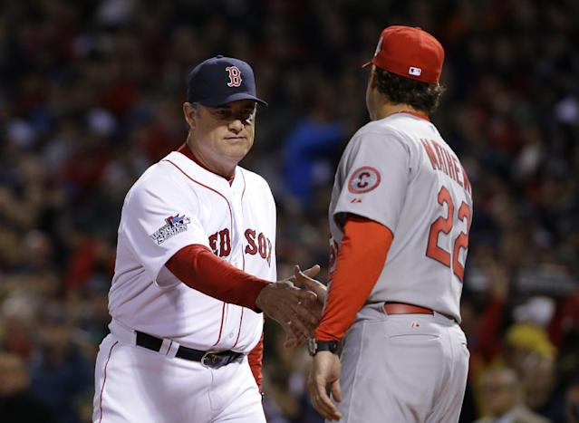 Boston Red Sox manager John Farrell, left, shakes hands with St. Louis Cardinals manager Mike Matheny before Game 1 of baseball's World Series Wednesday, Oct. 23, 2013, in Boston. (AP Photo/Matt Slocum)