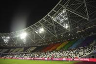 Fans are socially distanced as they wait for kick off ahead of the English Premier League soccer match between West Ham United and Manchester United at the London stadium in London, England, Saturday, Dec. 5, 2020. (Justin Setterfield/Pool Via AP)
