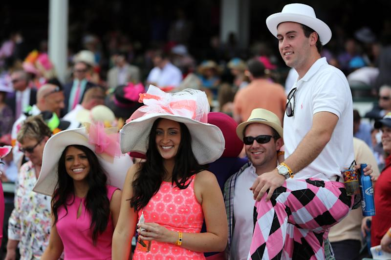 Fans in the stands celebrate before the Kentucky Oaks at Churchill Downs Friday, May 3, 2013, in Louisville, Ky. Friday is Kentucky Oaks Day. (AP Photo/Gregory Payan)