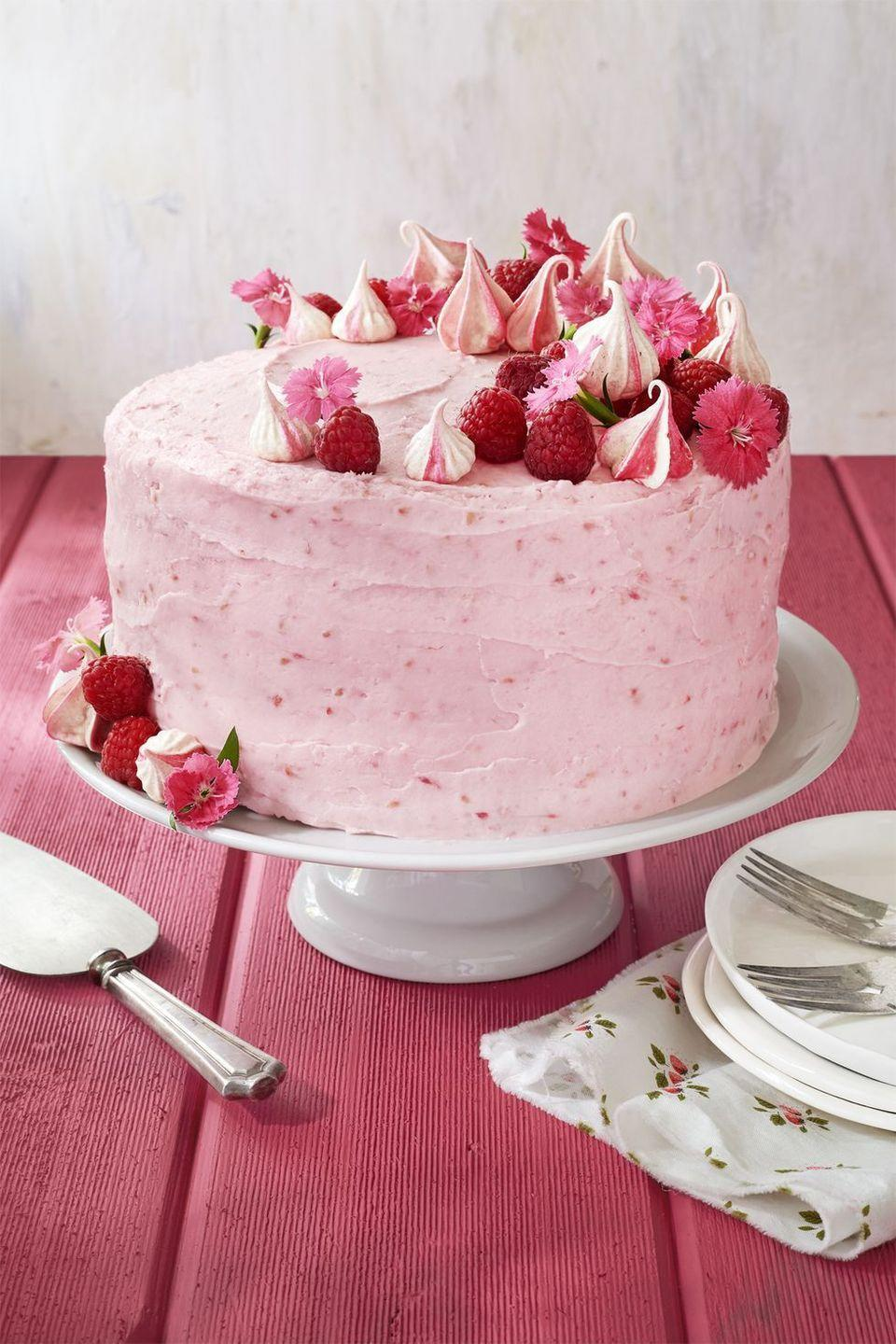 """<p>Just when you think it can't get any prettier than this raspberry cream frosting, there are meringue kisses and edible flowers.</p><p><em><a href=""""https://www.countryliving.com/food-drinks/recipes/a41986/raspberry-pink-velvet-cake-recipe/"""" rel=""""nofollow noopener"""" target=""""_blank"""" data-ylk=""""slk:Get the recipe for Raspberry Pink Velvet Cake with Raspberry Cream Cheese Frosting »"""" class=""""link rapid-noclick-resp"""">Get the recipe for Raspberry Pink Velvet Cake with Raspberry Cream Cheese Frosting »</a></em></p>"""