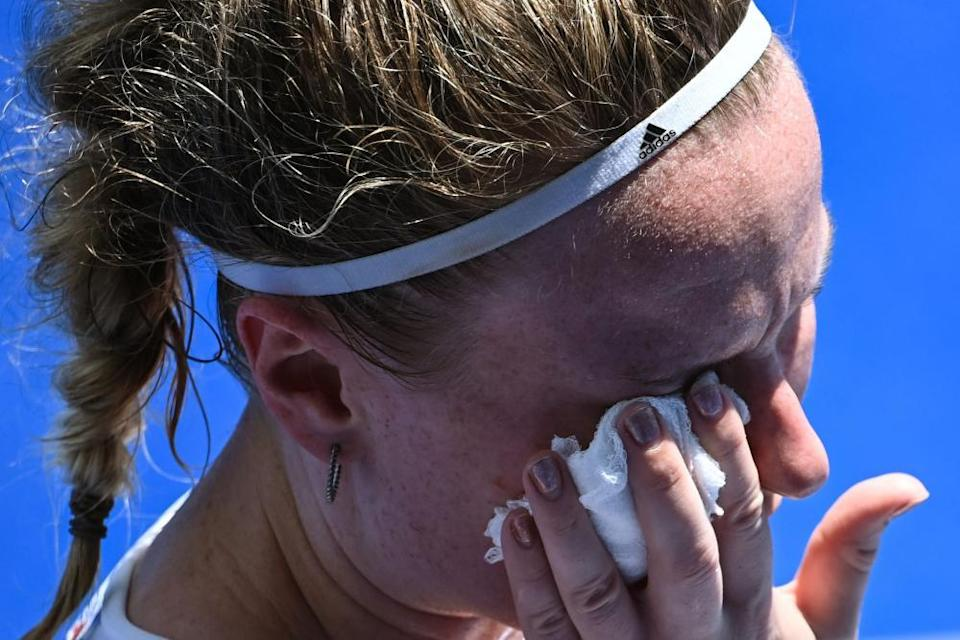 Hollie Pearne-Webb of Team GB sustains an injury during the women's semi-final of the hockey.