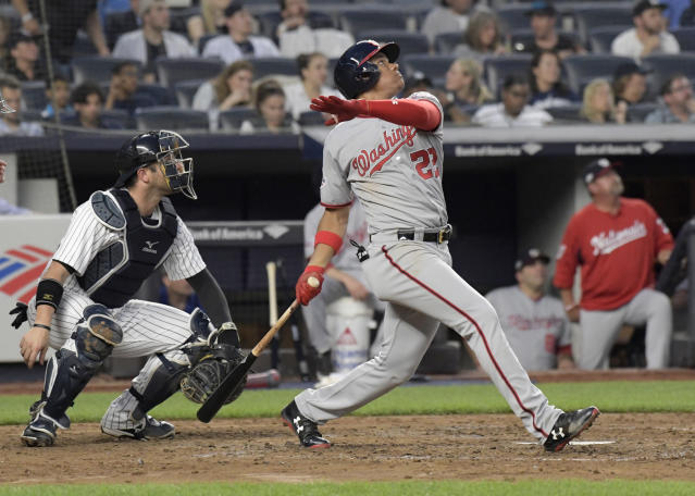 Washington Nationals' Juan Soto watches his three-run home run in front of New York Yankees catcher Austin Romine during the fourth inning of a baseball game Wednesday, June 13, 2018, at Yankee Stadium in New York. (AP Photo/Bill Kostroun)