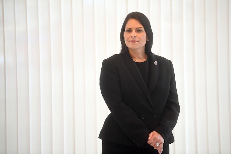 LONDON, ENGLAND - SEPTEMBER 25: Home Secretary Priti Patel observes a minute's silence inside the atrium at Scotland Yard on September 25, 2020 in London, England. A murder investigation has been launched following the death of a police officer at the Croydon Custody Centre in south London. He was shot by a 23-year-old man who was also treated for a gunshot wound. The officer died later in hospital. The death will be investigated by the Independent Office for Police Conduct. (Photo by Victoria Jones - WPA Pool/Getty Images)