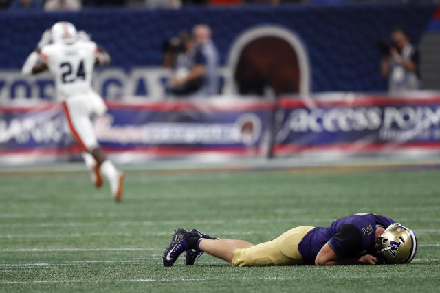 Washington Huskies quarterback Jake Browning (3) lies on the turf as an Auburn player celebrates during the second half Sept. 1, 2018, in Atlanta. Auburn won 21-16. (AP Photo/John Bazemore)