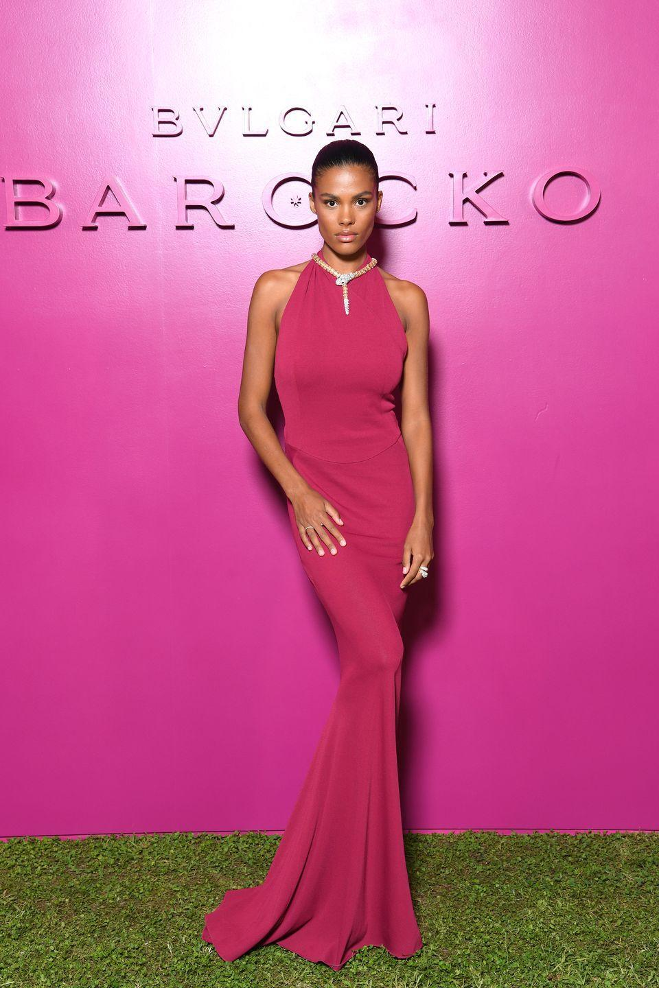 <p><strong>15 September </strong>Tina Kunakey paired her Bulgari serpent necklace with a fuchsia Alaia gown.</p>