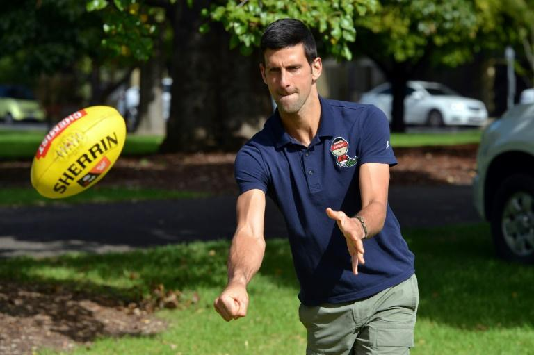 Men's tennis world number one Novak Djokovic played with an Australian Rules football after his two-week quarantine in Adelaide
