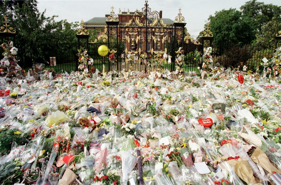Thousands of flowers cover the gate entrance of Kensington Palace,  September 1, a day after the announcement of Princess Diana's death. [Many Londoners stopped off at Kensington Palace on their way to work to pay respects to Princess Diana who was killed in a car accident in Paris, August 31, with her friend Dodi Al Fayed and a chauffer].