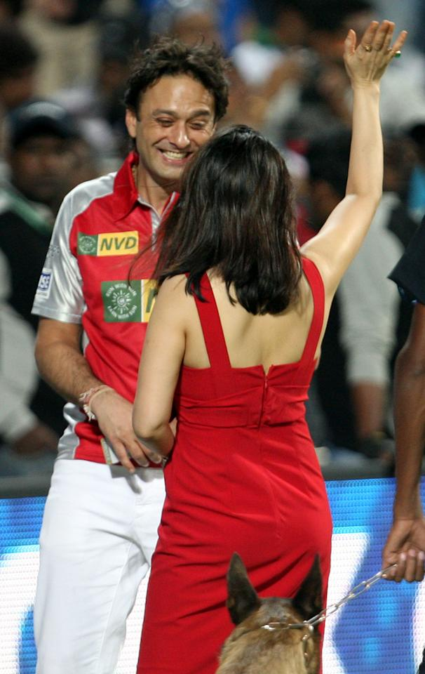 Ness Wadia congratulating Preity Zinta, both owners of Kings XI Punjab during the match between Pune Warriors and Kings XI Punjab in Pune on April 7, 2013. (Photo: IANS)