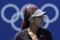 Naomi Osaka, of Japan, practices for the women's tennis competition ahead of the 2020 Summer Olympics, Friday, July 23, 2021, in Tokyo, Japan. (AP Photo/Patrick Semansky)