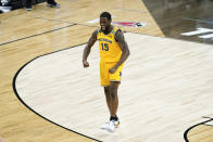 Michigan guard Chaundee Brown celebrates at the end of a Sweet 16 game against Florida State in the NCAA men's college basketball tournament at Bankers Life Fieldhouse, Sunday, March 28, 2021, in Indianapolis. Michigan won 76-58. (AP Photo/Darron Cummings)