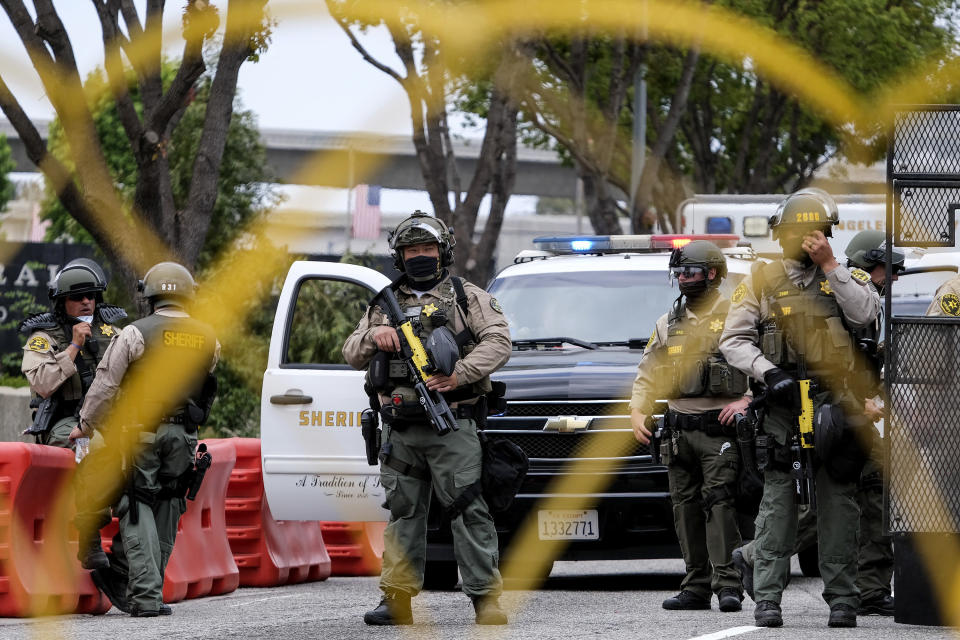 Police officers guard outside the Federal Building during a protest against Israel and in support of Palestinians, Saturday, May 15, 2021, in the Westwood section of Los Angeles. (AP Photo/Ringo H.W. Chiu)