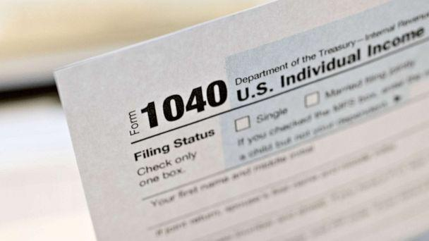 PHOTO: A U.S. Department of the Treasury Internal Revenue Service (IRS) 1040 Individual Income Tax form for the 2019 tax year is arranged for a photograph in Tiskilwa, Ill., March 20, 2020. (Daniel Acker/Bloomberg via Getty Images)