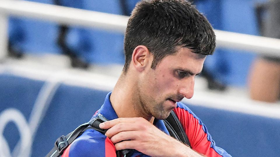 Pictured here, Novak Djokovic leaves Tokyo empty handed after failing to win a medal in singles or doubles.