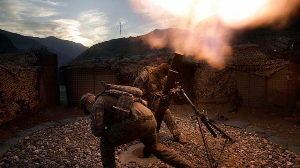 PHOTO: U.S. soldiers from the 2nd Battalion, 12th Infantry Regiment, 4th Brigade Combat Team, 4th Infantry Division fire mortars in the Pech Valley of Afghanistan's Kunar province, Oct. 26, 2009. (David Guttenfelder/AP, FILE)