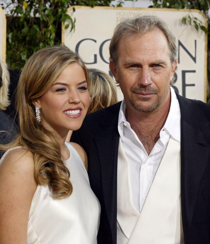 Kevin Costner  poses with his daughter Lily (Miss Golden Globe) at the 61st Annual Golden Globe Awards at the Beverly Hilton Hotel on January 25, 2004 in Beverly Hills, California. (Photo by Carlo Allegri/Getty Images)