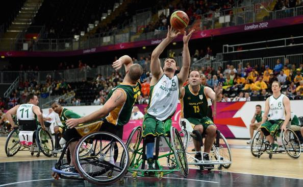 Bill Latham of Australia shoots while under pressure from Richard Nortje and Stuart Jellows of South Africa during the Group A Preliminary Men's Wheelchair Basketball match between Australia and South Africa on day 1 of the London 2012 Paralympic Games at Basketball Arena on August 30, 2012 in London, England. (Photo by Christopher Lee/Getty Images)