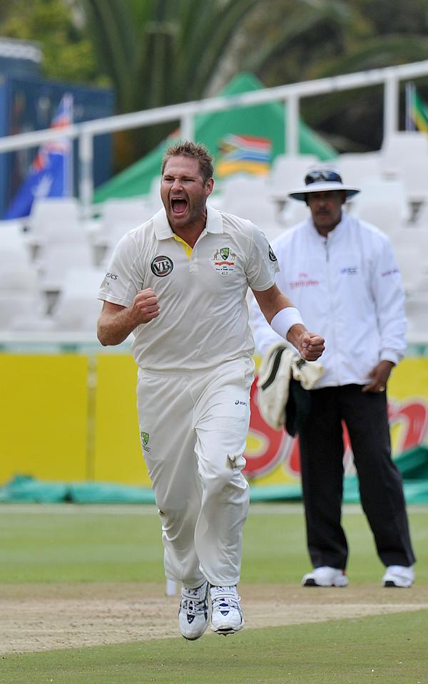 Australian  Ryan Harris celebrates after taking the wicket of unseen South African cricketer  Jacques Rudolph for  18runs  on day 2 of the 1st Test between Australia and  South Africa at Newlands Stadium in Cape Town on November 10, 2011. AFP PHOTO / ALEXANDER JOE (Photo credit should read ALEXANDER JOE/AFP/Getty Images)