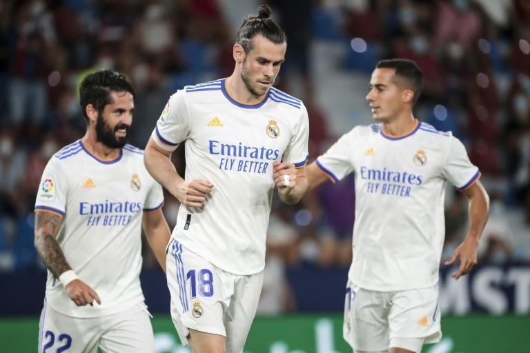Long wait: Gareth Bale receives congratulations from Isco, left, and Lucas Vazquez, right after scoring
