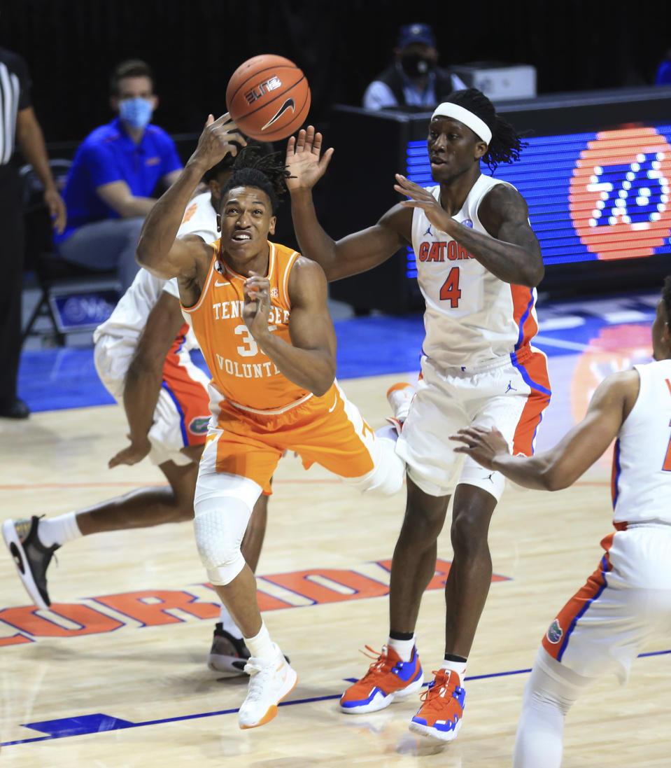 Tennessee guard Yves Pons (35) shoots past Florida forward Anthony Duruji (4) during the first half of an NCAA college basketball game Tuesday, Jan. 19. 2021, in Gainesville, Fla. (AP Photo/Matt Stamey)