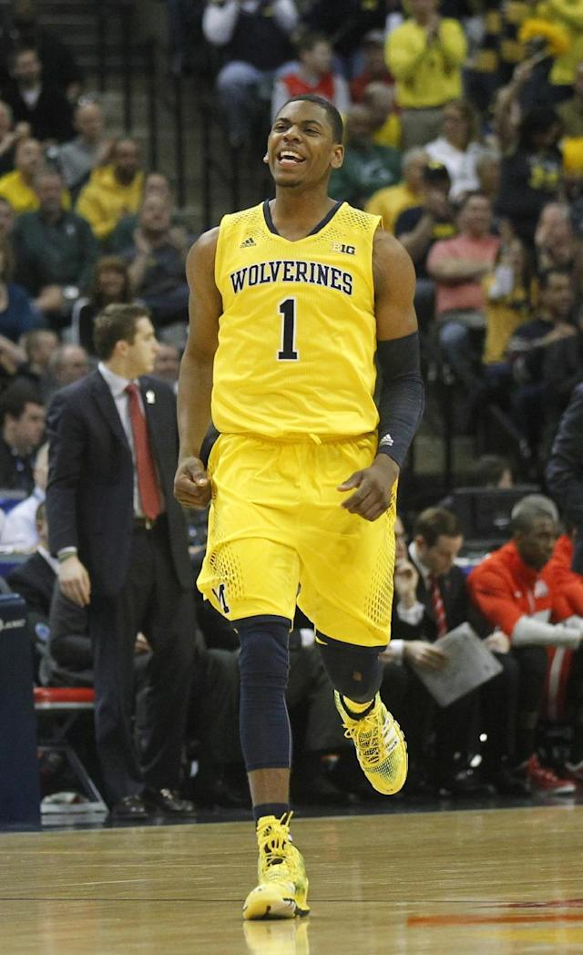 Michigan forward Glenn Robinson III celebrates after sinking a three pointer in the first half of an NCAA college basketball game against Ohio State in the semifinals of the Big Ten Conference tournament Saturday, March 15, 2014, in Indianapolis. (AP Photo/Kiichiro Sato)