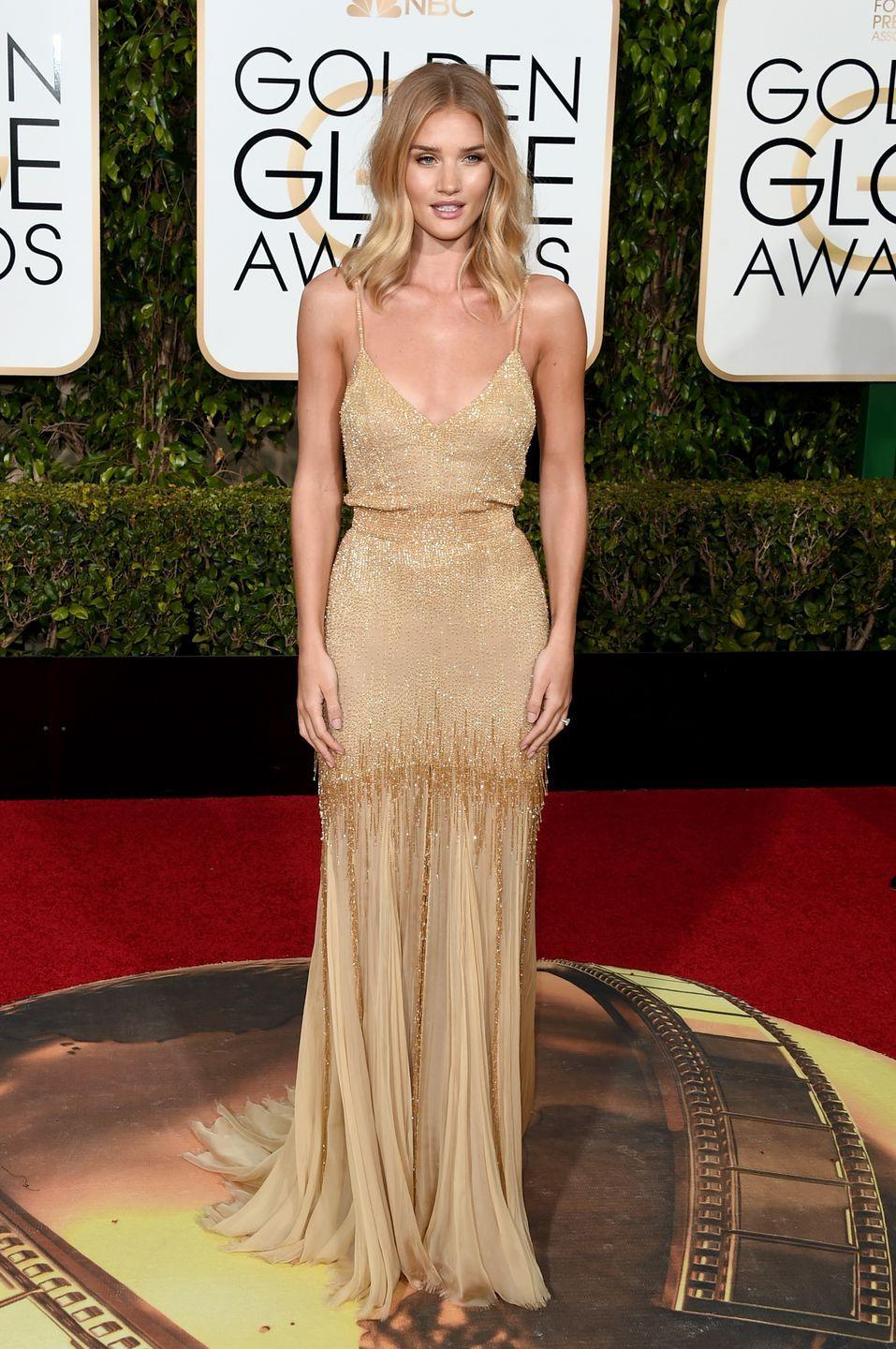 <p>The supermodel gave us sun-kissed goddess in Saint Laurent at the 2015 ceremony.</p>