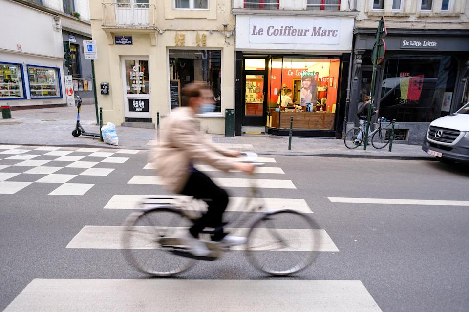 BRUSSELS, BELGIUM - OCTOBER 21: A ciclyst ride his bike over a Pedestrian crossing on the 'Rue de l'Ecuyer' on October 21, 2020 in Brussels, Belgium. Europe is seeing a rise in schemes to support cycling, as governments look to protect their public transport systems, boost public health and capitalize on clean-air gains as they take their first steps out of COVID-19 lockdowns. (Photo by Thierry Monasse/Getty Images) (Photo: Thierry Monasse via Getty Images)
