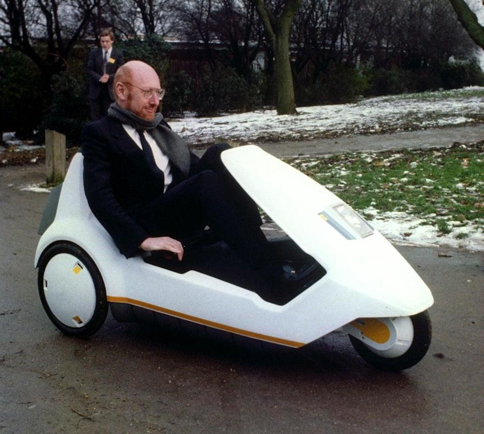 Inventor Sir Clive Sinclair demonstrates his battery-assisted pedal-powered tricycle (PA) (PA Archive)