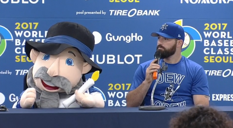 Cody Decker with Team Israel's good luck charm, Mensch on the Bench. (MLB.com)