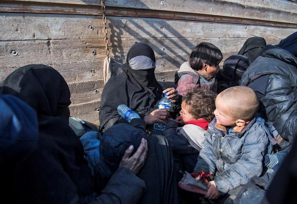A woman claiming to be a 31-year-old from France who fled the Islamic State group's last pocket in Syria sits in the back of a truck, near Baghouz, eastern Syria, on February 11, 2019 (AFP Photo/Fadel SENNA)