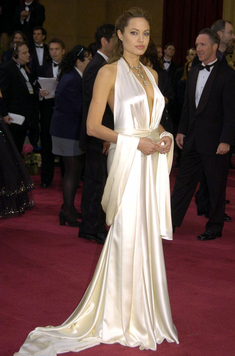 <p>Angie stunned in this silky cream-colored halter dress, and let's be real: Only she could make a coordinating shawl THIS glam. She definitely channeled old Hollywood style in this classic look. </p>