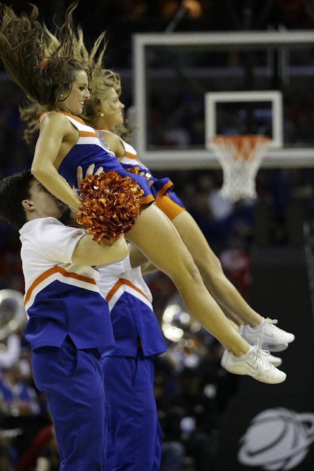 Florida cheerleaders perform during the first half in a regional final game against Dayton at the NCAA college basketball tournament, Saturday, March 29, 2014, in Memphis, Tenn. (AP Photo/Mark Humphrey)