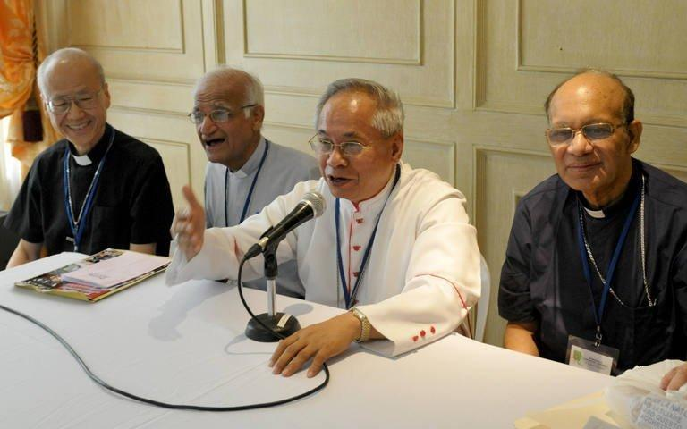 Filipino Archbishop Orlando Quevedo (2-R) speaks during a press briefing in Manila on August 15, 2009