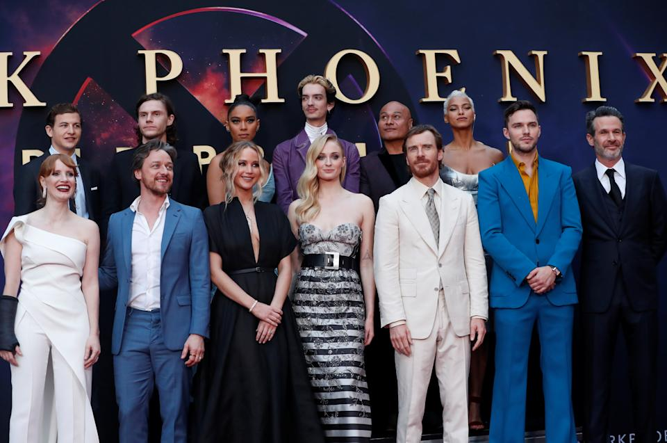 """Director Simon Kinberg poses with the cast of """"Dark Phoenix"""" during the film's premiere in Los Angeles, California, U.S., June 4, 2019. REUTERS/Mario Anzuoni"""