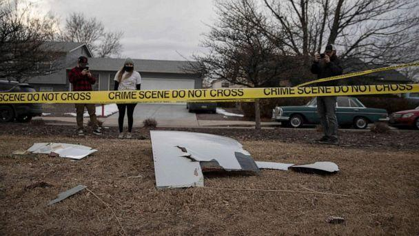 PHOTO: Residents take pictures of debris fallen from a United Airlines airplane's engine on the neighborhood of Broomfield, Colorado, Feb. 20, 2021. (Chet Strange/AFP via Getty Images)