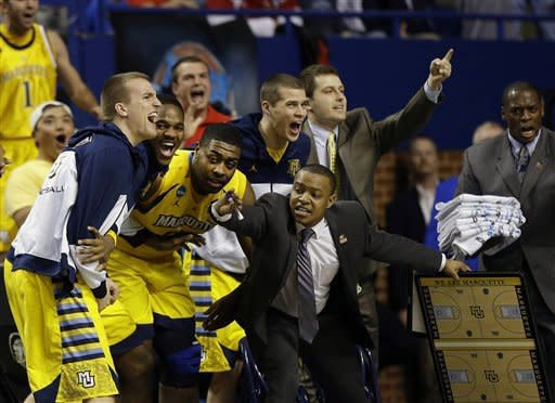 The Marquette bench reacts after a basket in the second half of a third-round NCAA college basketball tournament game against Butler, Saturday, March 23, 2013, in Lexington, Ky. (AP Photo/John Bazemore)